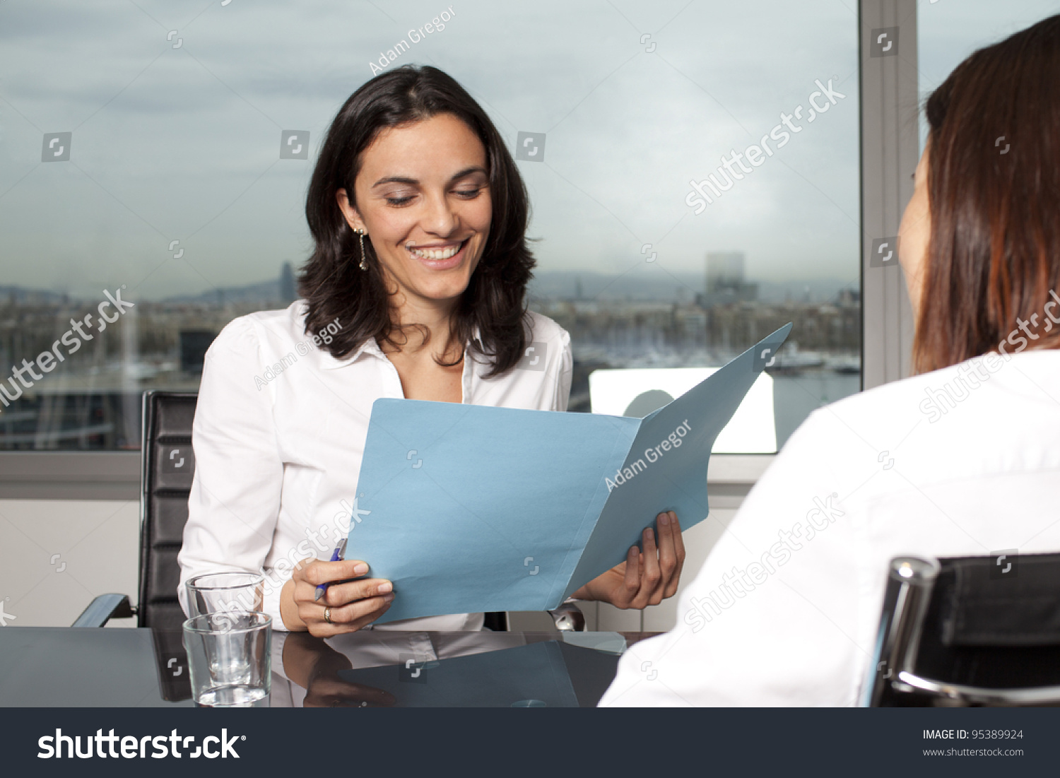 recruiter checking the cv during job interview stock photo save to a lightbox