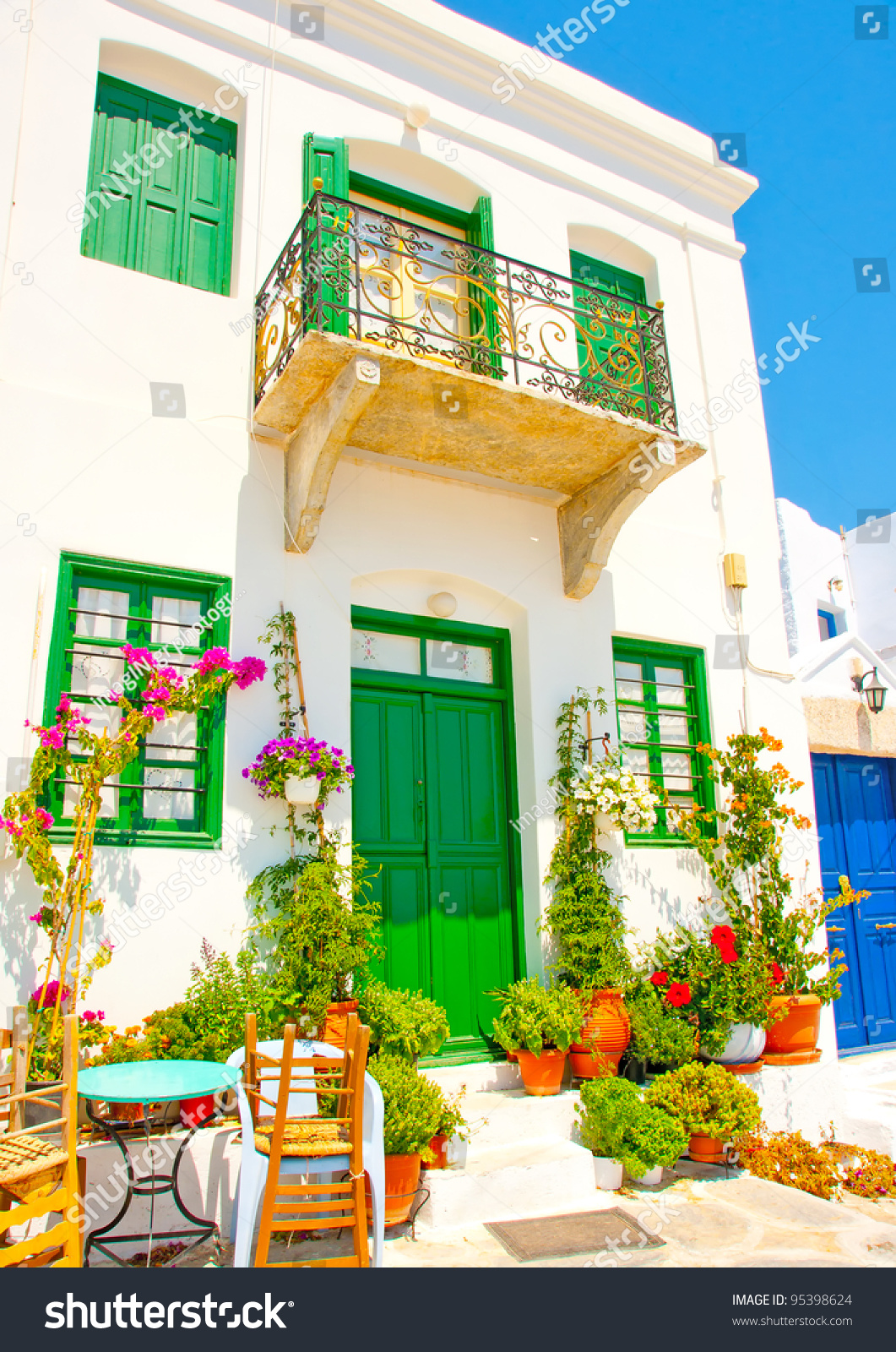 Old beautiful traditional house in chora the capital of amorgos island - Beautiful Old Traditional House With Wooden Green Colored Doors And Windows In Chora The Capital Of