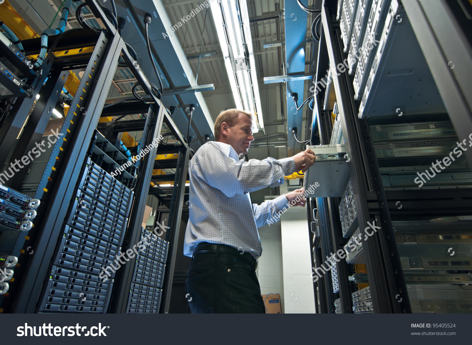 Administrator - It administrator installing a new rack mount server large scale storage server is also seen