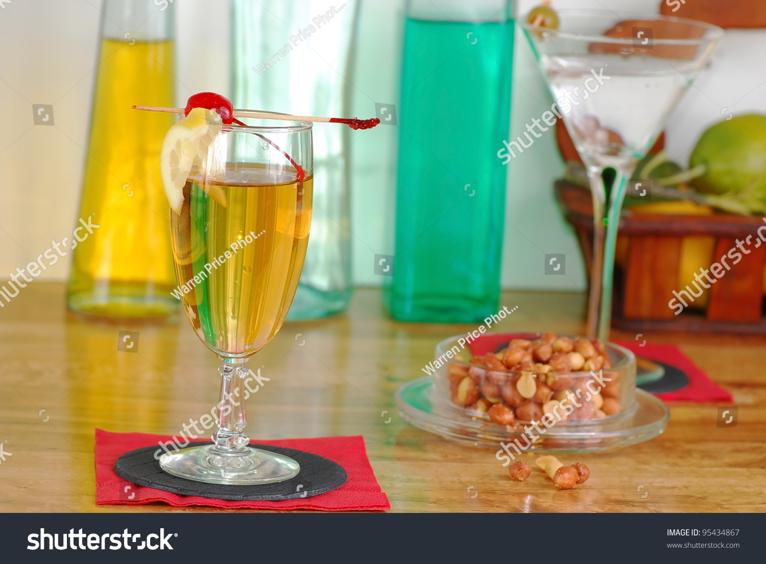 Martini, Whiskey Sour, hot nuts and assorted colorful bottles of ...