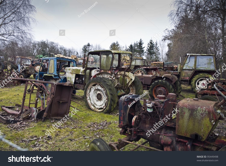 Old tractors on scrap yard jutland stock photo 95449498 for Scrap tractor tires