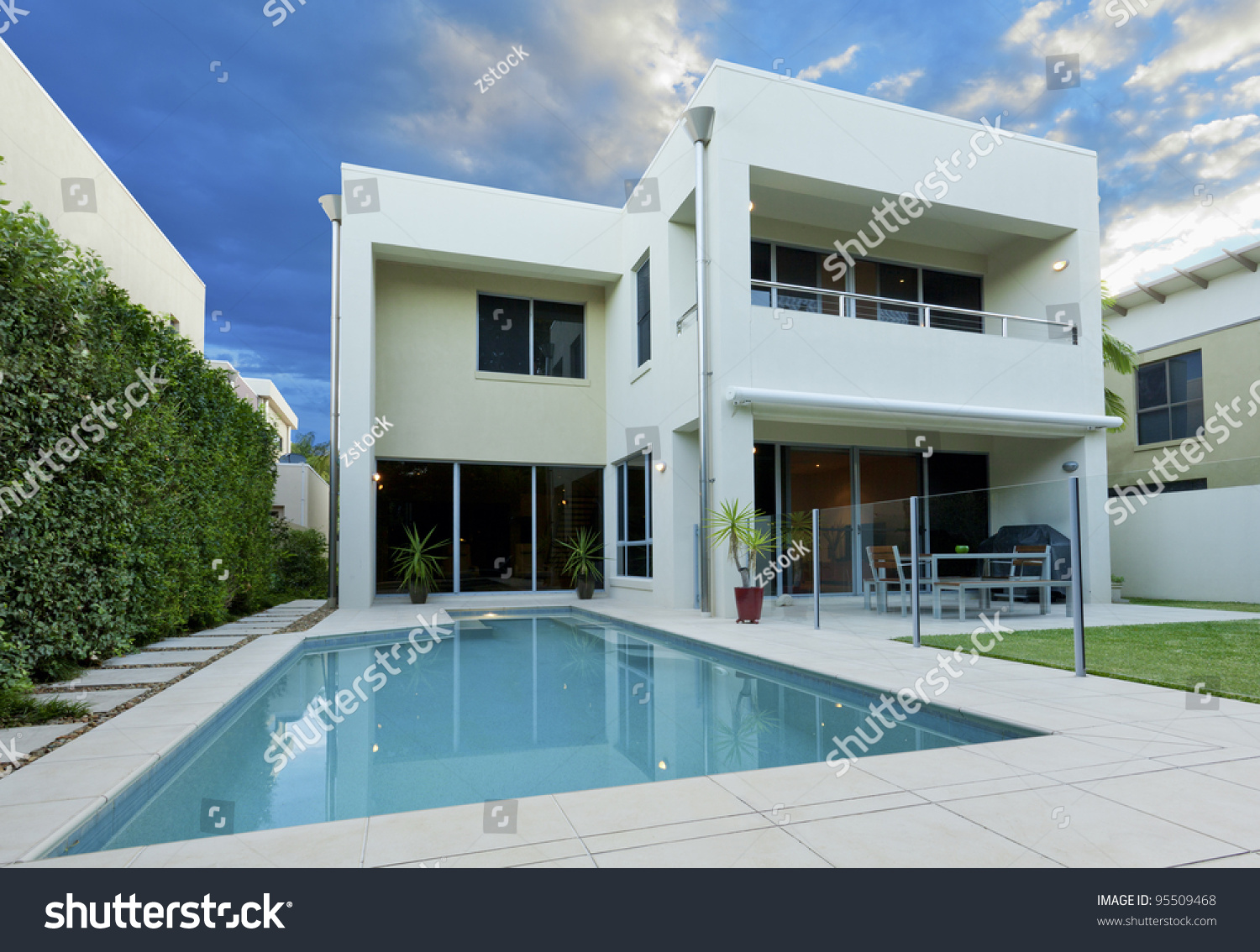 luxurious modern house swimming pool backyard stock photo 95509468 shutterstock. Black Bedroom Furniture Sets. Home Design Ideas