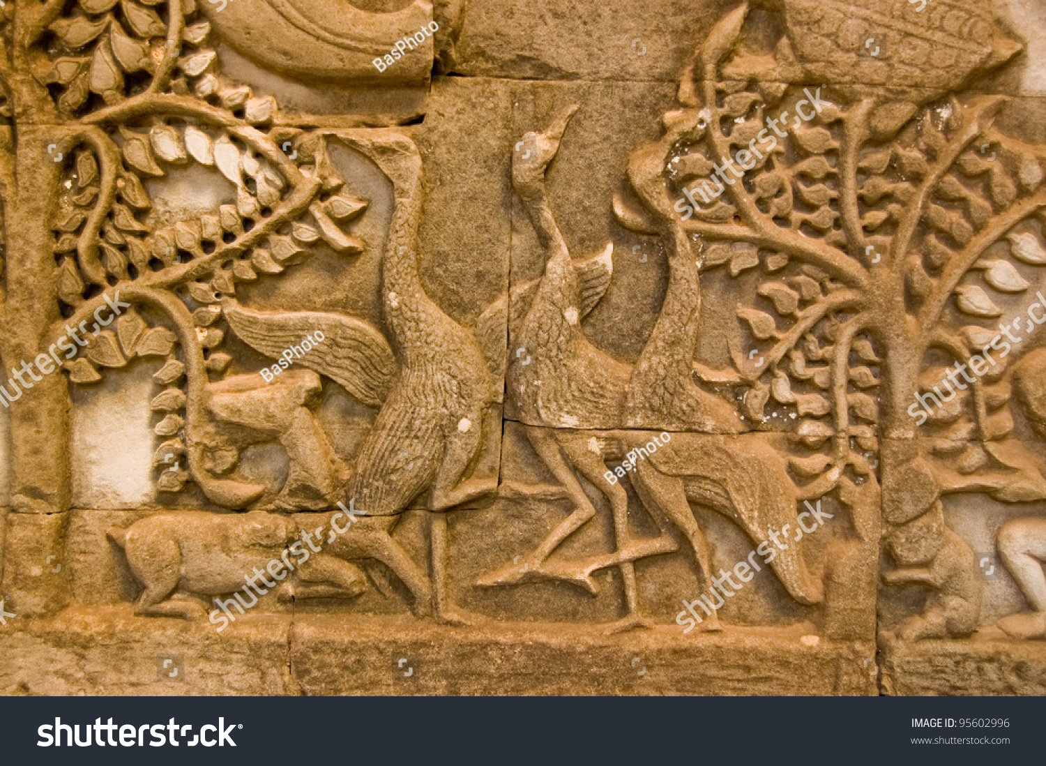 Ancient bas relief carving three geese stock photo