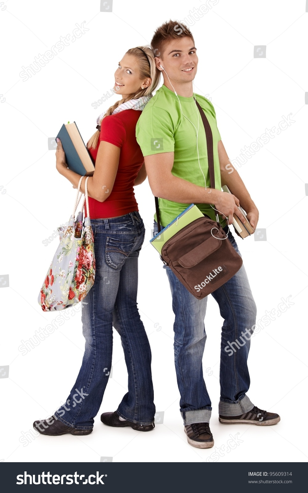 Happy Trendy College Students With Bags And Books Posing Together Smiling At Camera