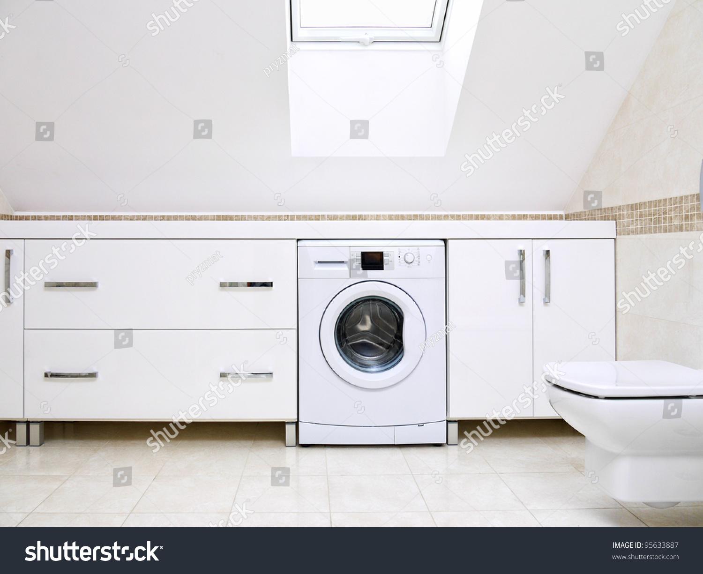 washing machine in bathroom cupboard