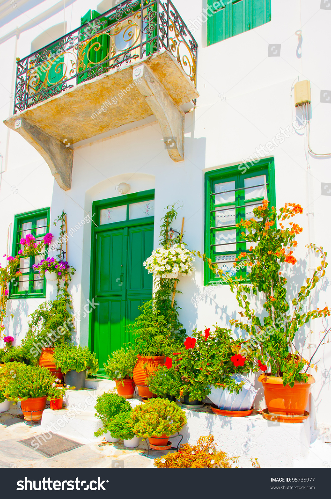 Old beautiful traditional house in chora the capital of amorgos island - Beautiful Old Traditional House With Wooden Green Colored Doors And Windows In Chora The Capital Of Preview Save To A Lightbox