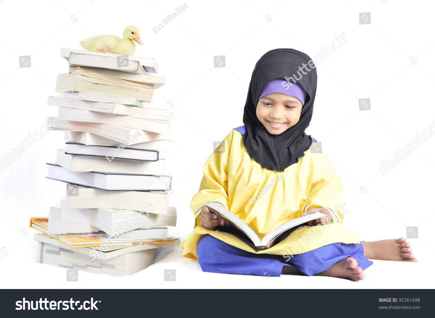 Cute muslim girl reading book in isolated white background 95761498