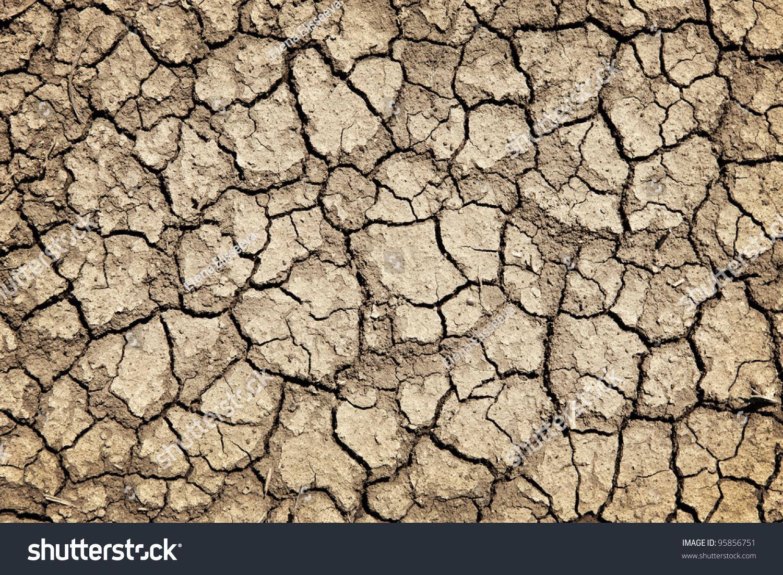 Background dry cracked soil dirt earth stock photo for Earth or soil
