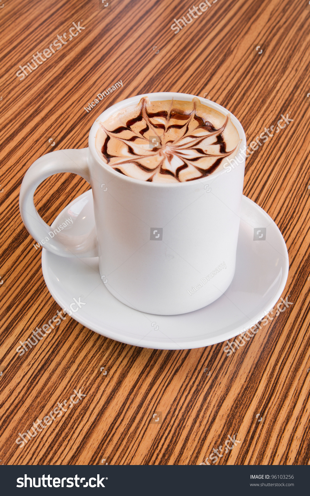 large cup of coffee decorated with milk froth and chocolate drawing stock photo 96103256. Black Bedroom Furniture Sets. Home Design Ideas