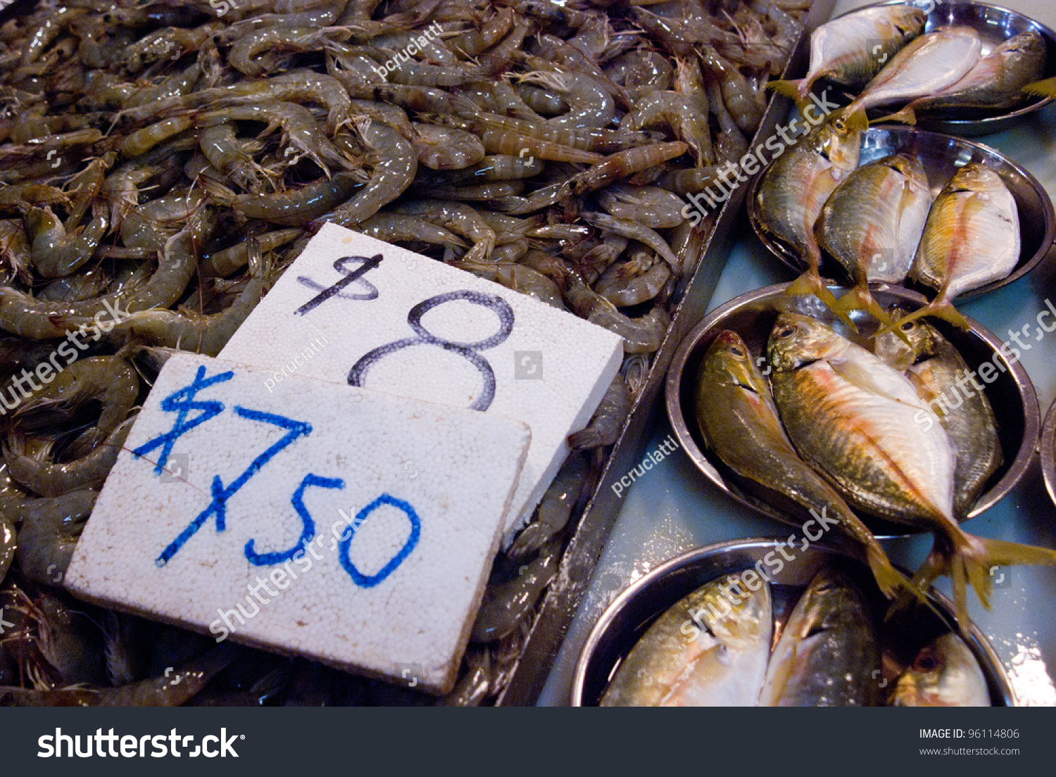 Fresh fish at the market with price tags stock photo for Fish stocking prices