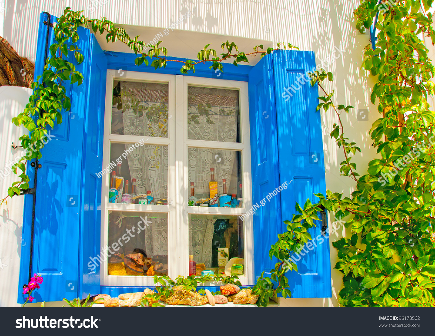 Old beautiful traditional house in chora the capital of amorgos island - Beautiful Wooden Blue Colored Window In An Old House In Chora Of Amorgos Island In Greece