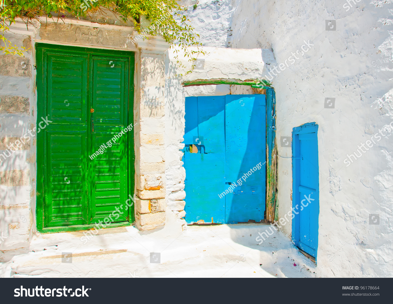 Old beautiful traditional house in chora the capital of amorgos island - Beautiful Old Traditional House With Wooden Green And Blue Colored Doors In Chora The Capital Of