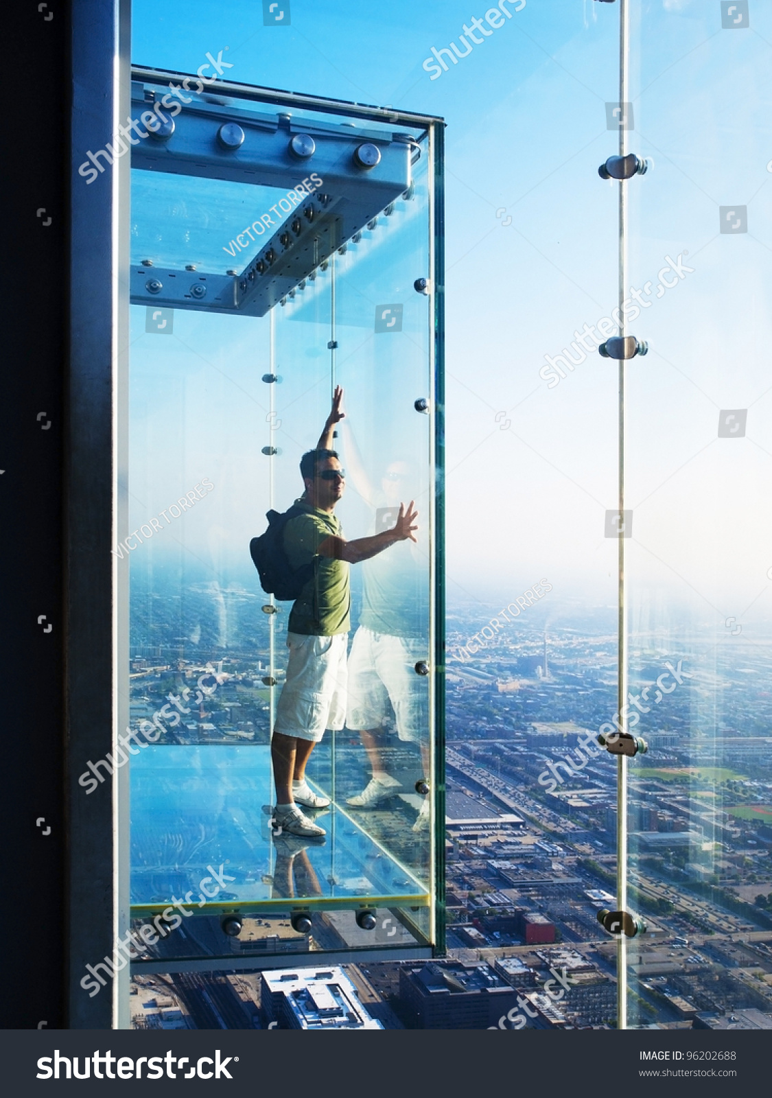 Tourist in the ledge glass balconies in 103th floor of for 103 floor skyscraper the sears tower in chicago