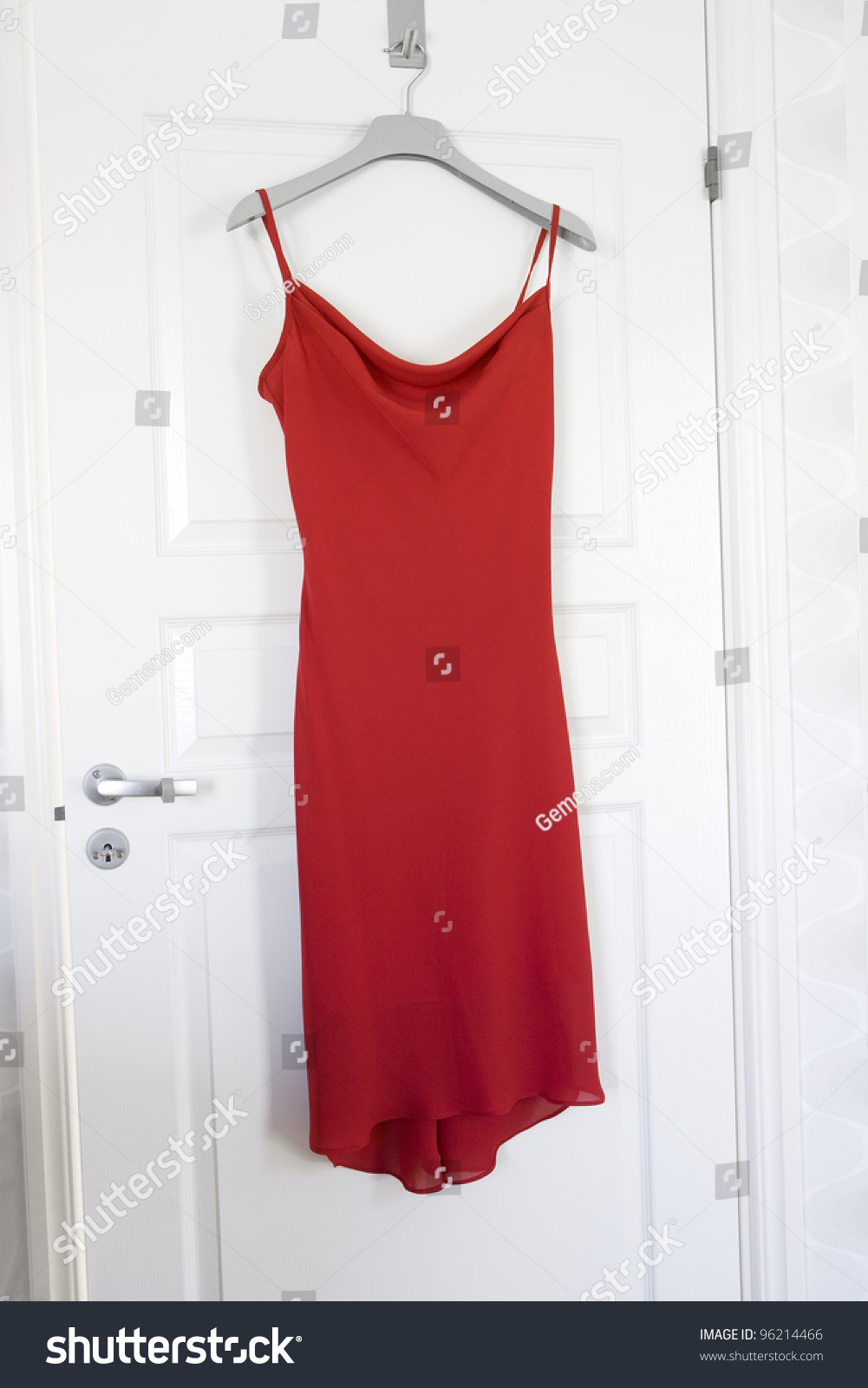 Red Dress Hanging On A Door Stock Photo 96214466