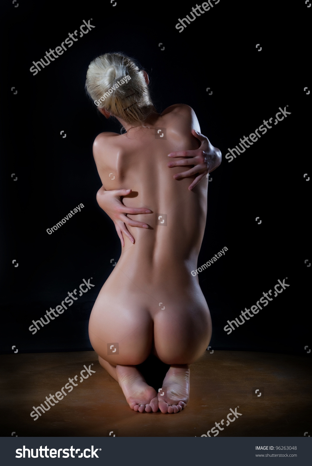 Female Beautiful Nude Woman Hugging Her Stock Photo -3875