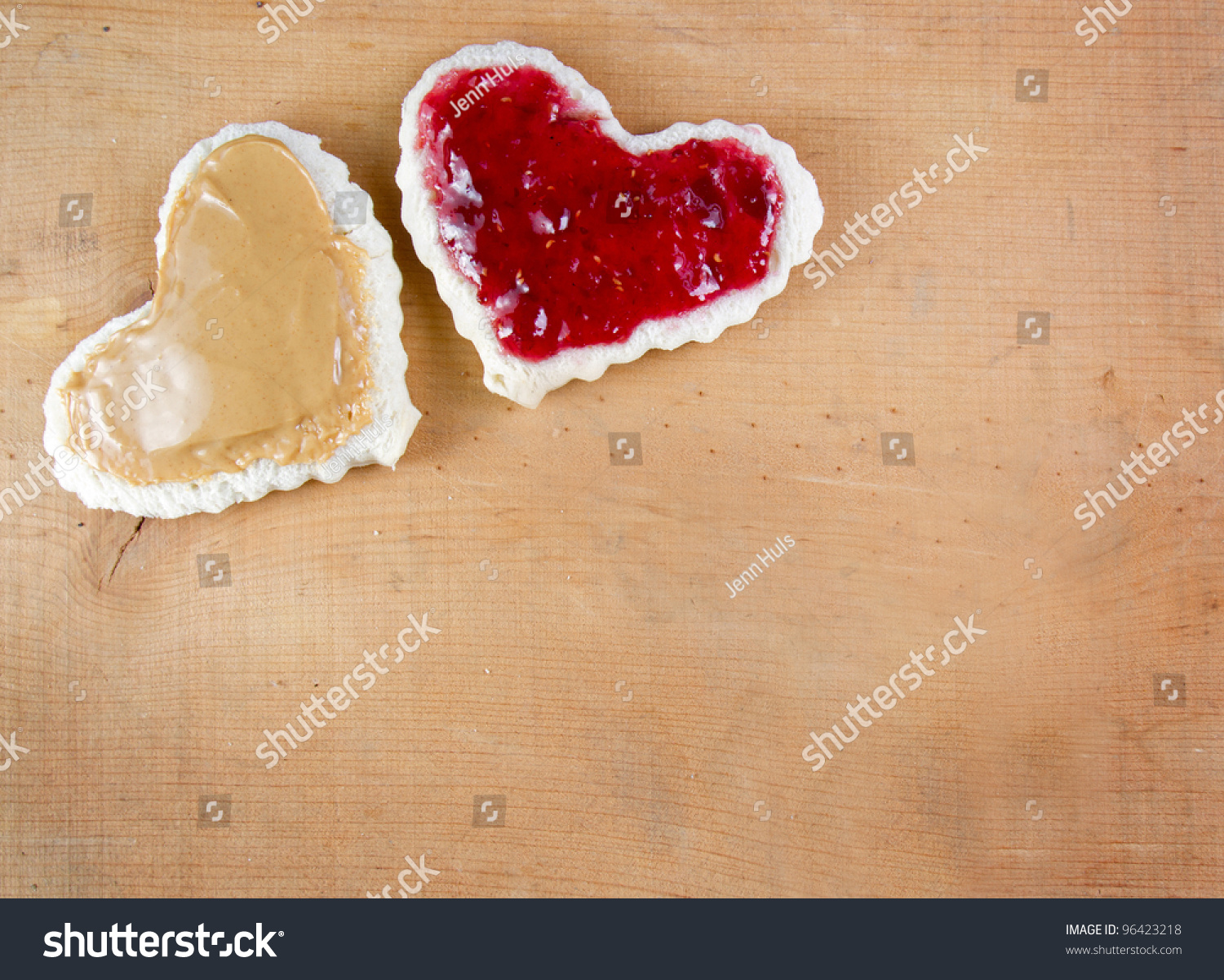 Peanut butter and jelly sandwich cut in a heart shape on a wooden ...