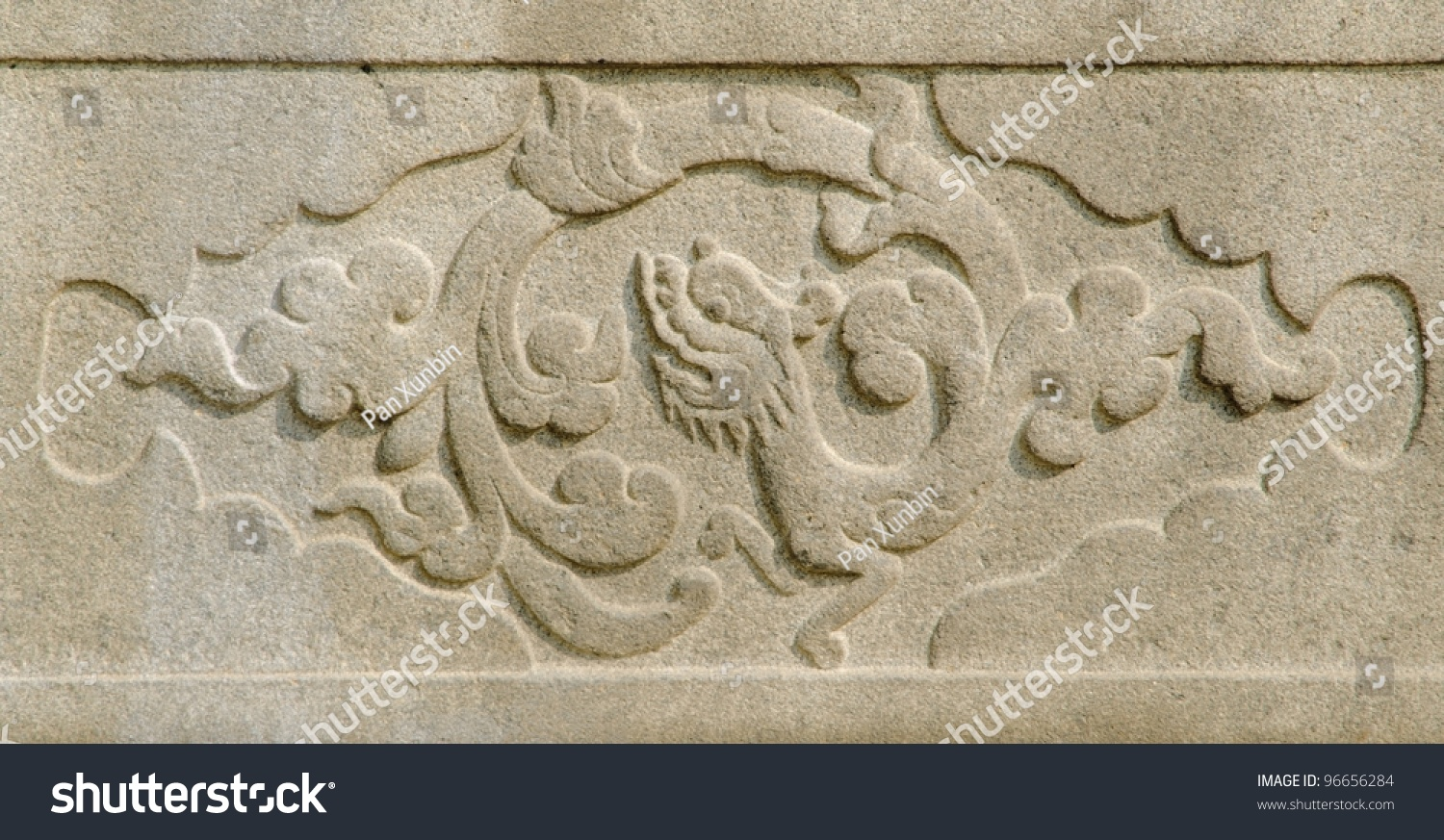 Chinese stone dragon carving relief stock photo