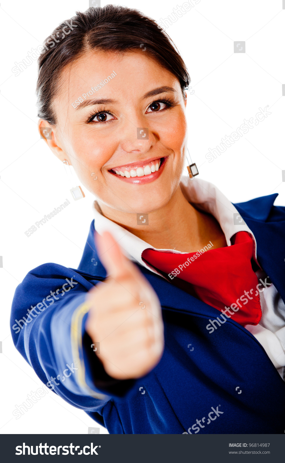 Happy flight attendant with thumbs up - isolated over a white background