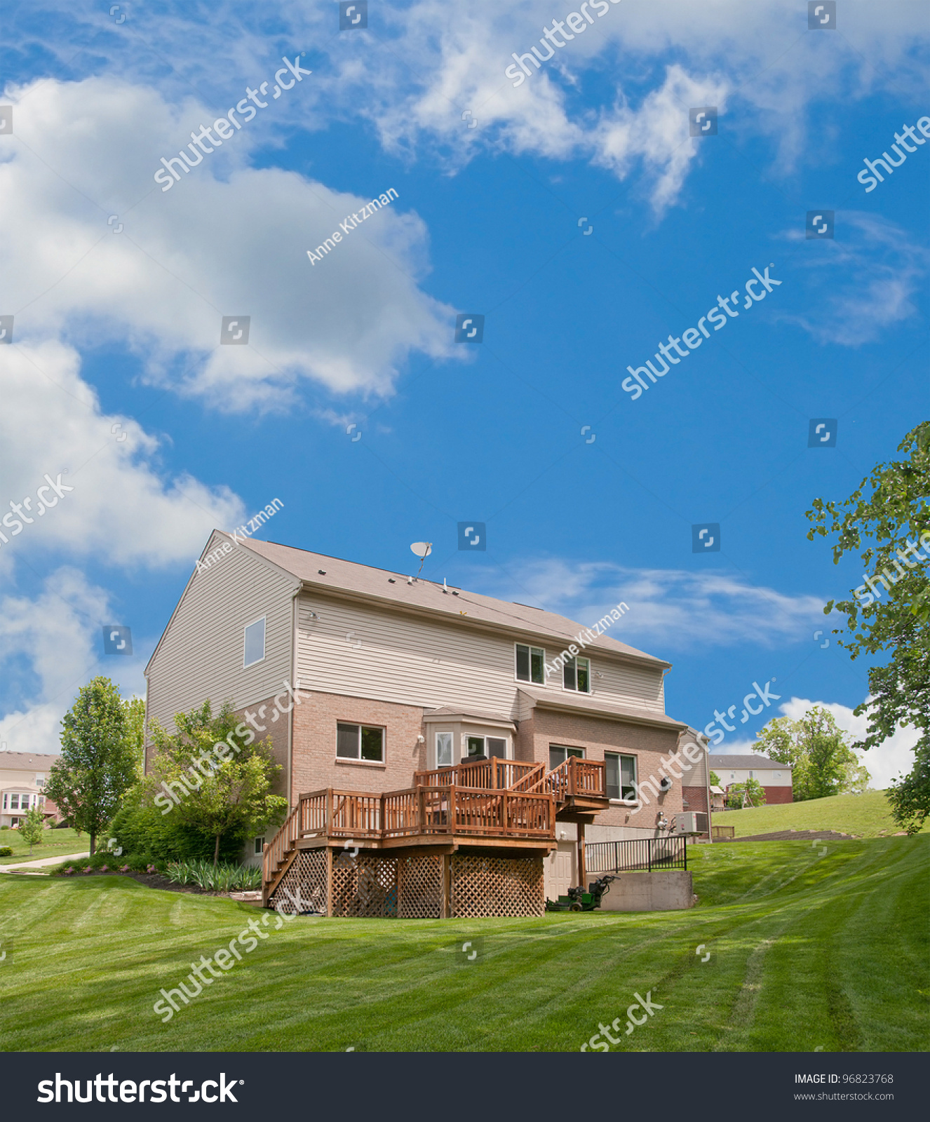 Twostory Brick Vinyl Siding House Back Stock Photo