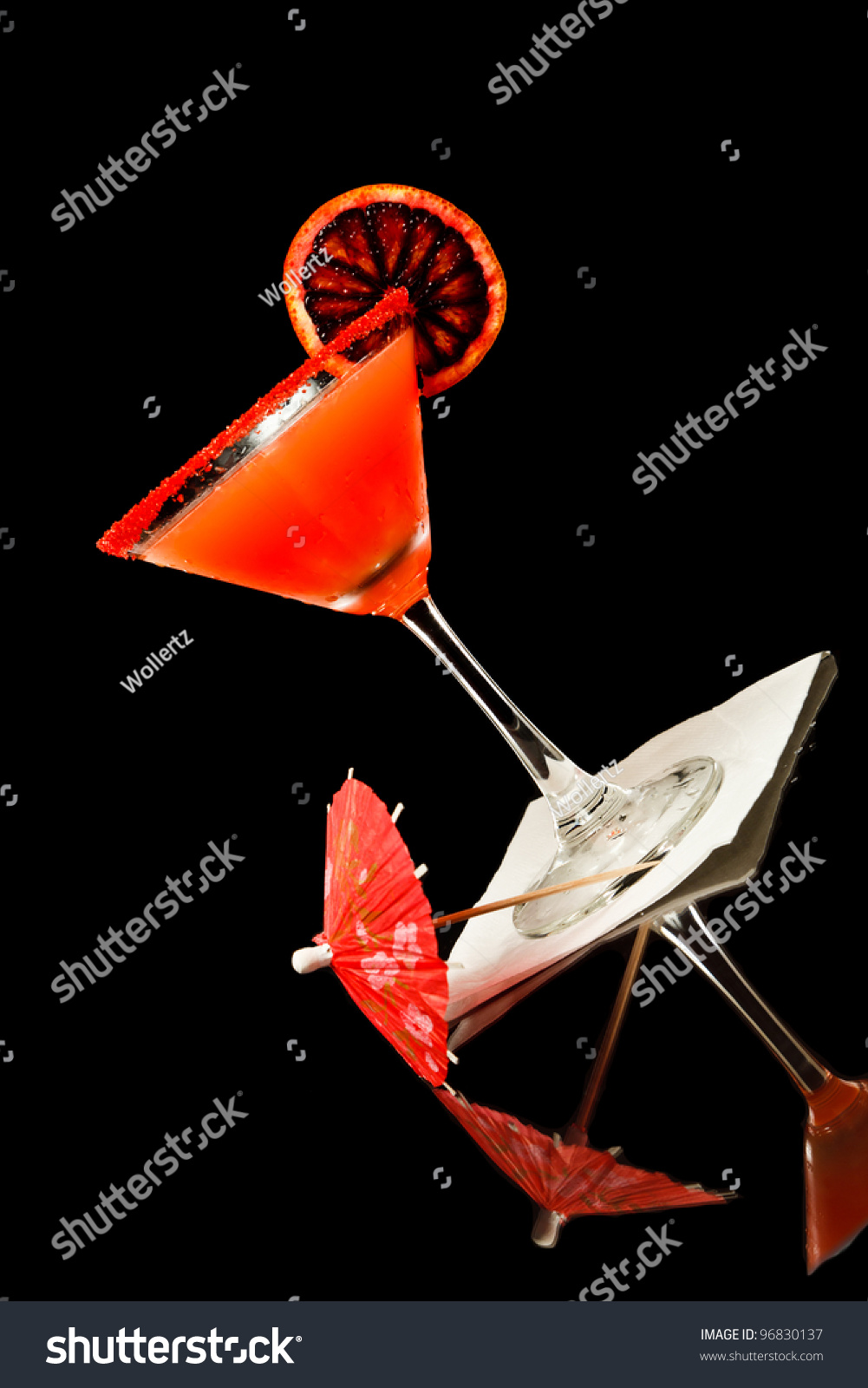 Blood Orange Color Martini Isolated On A Black Background