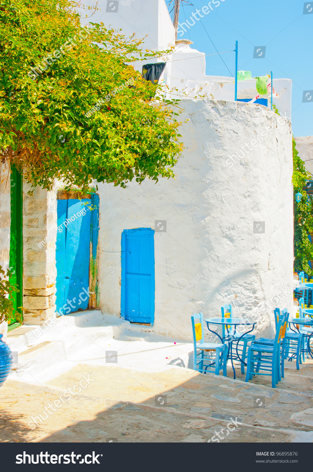 Old beautiful traditional house in chora the capital of amorgos island - Beautiful Stone Made Road With Old Traditional Houses And Traditional Iron Made Blue Coffee Tables And Chairs In Chora The Capital Of Amorgos Island In