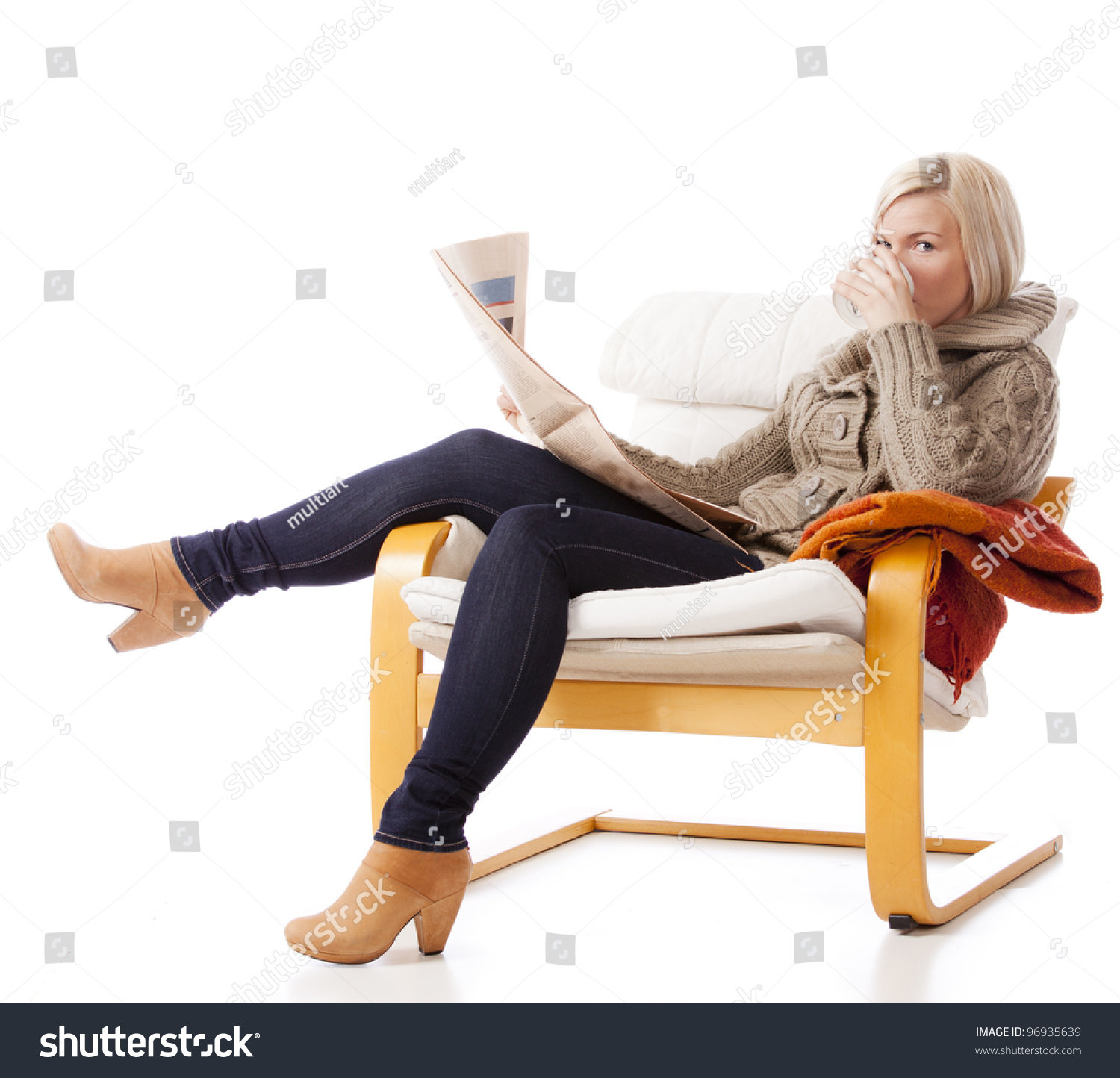 Young casual woman sitting armchair reading stock photo for Sitting in armchair