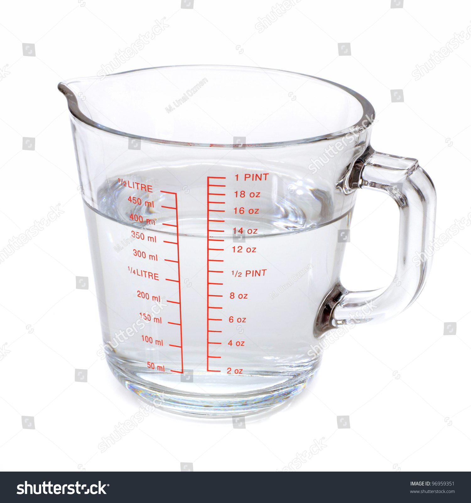 Water in measuring cup isolated on white   Royalty Free Stock ...