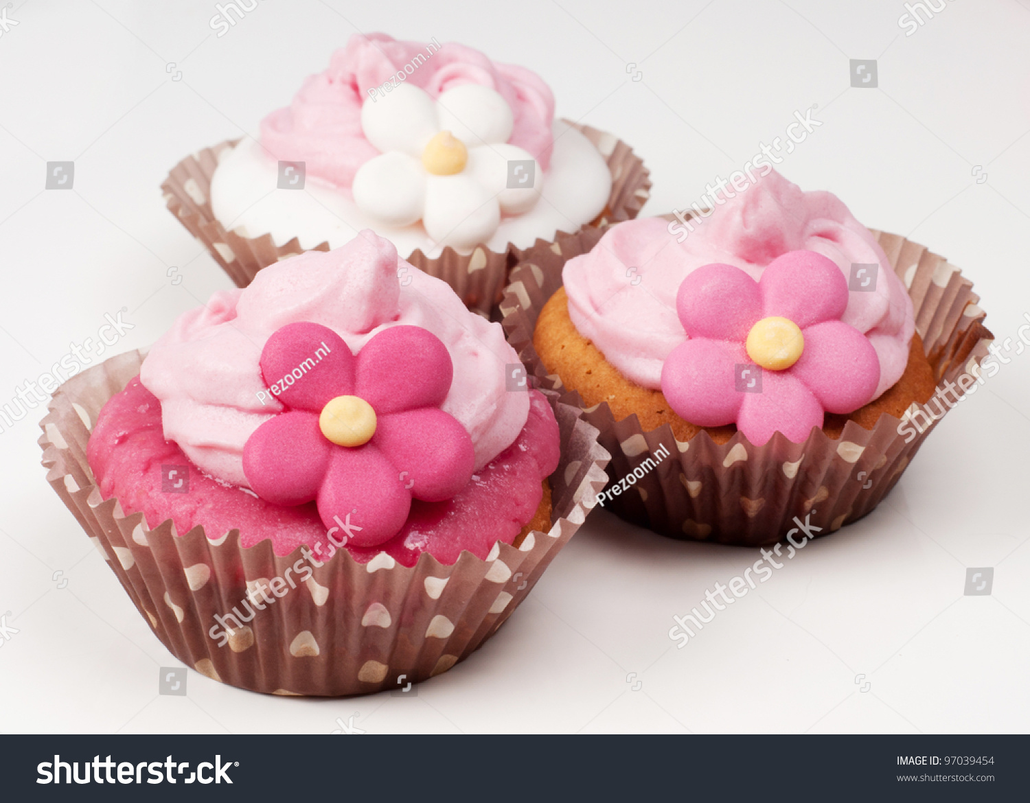 Three Pink Flower Cupcakes Stock Photo Download Now 97039454