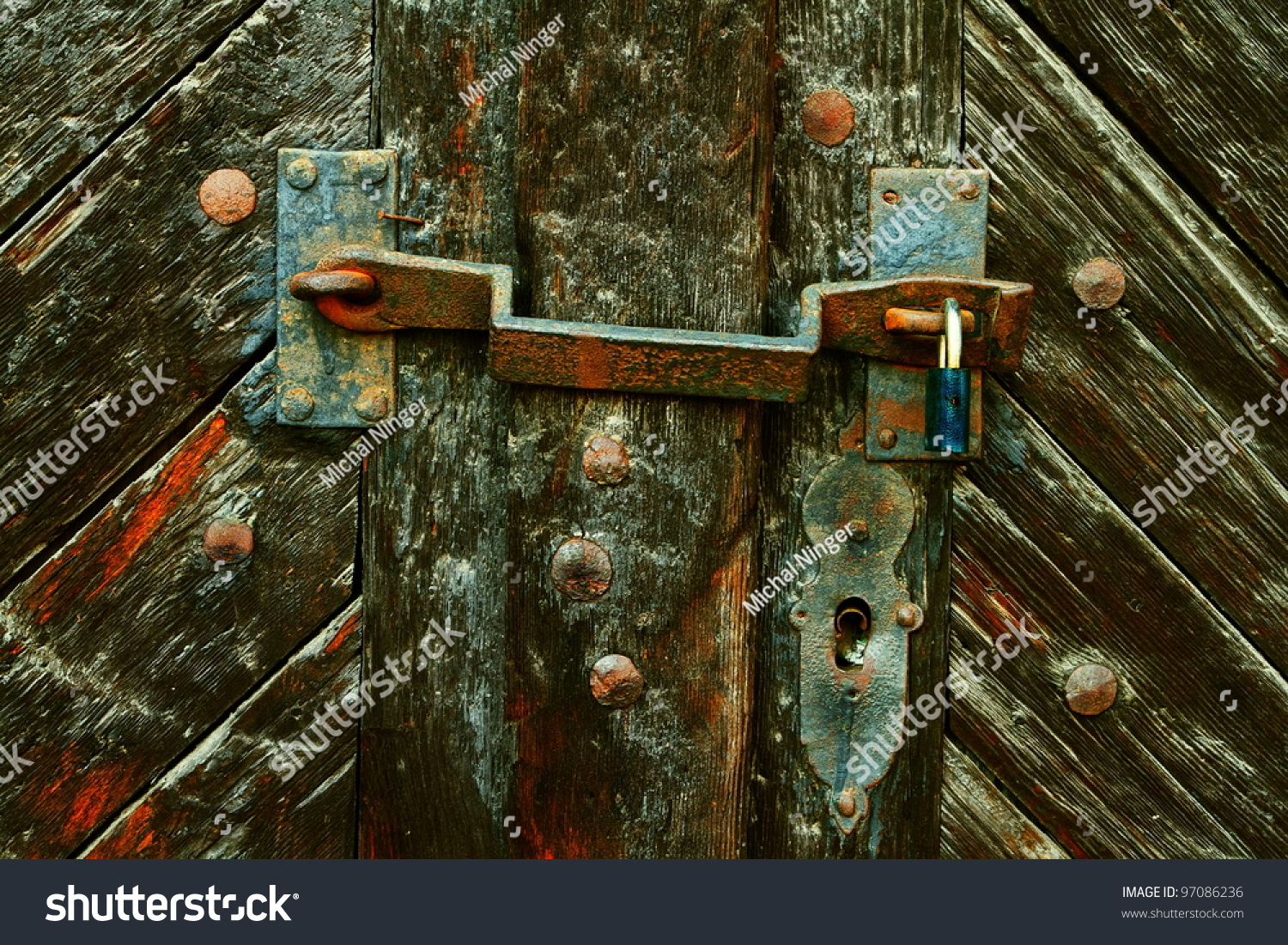 old doors with hasp and padlock