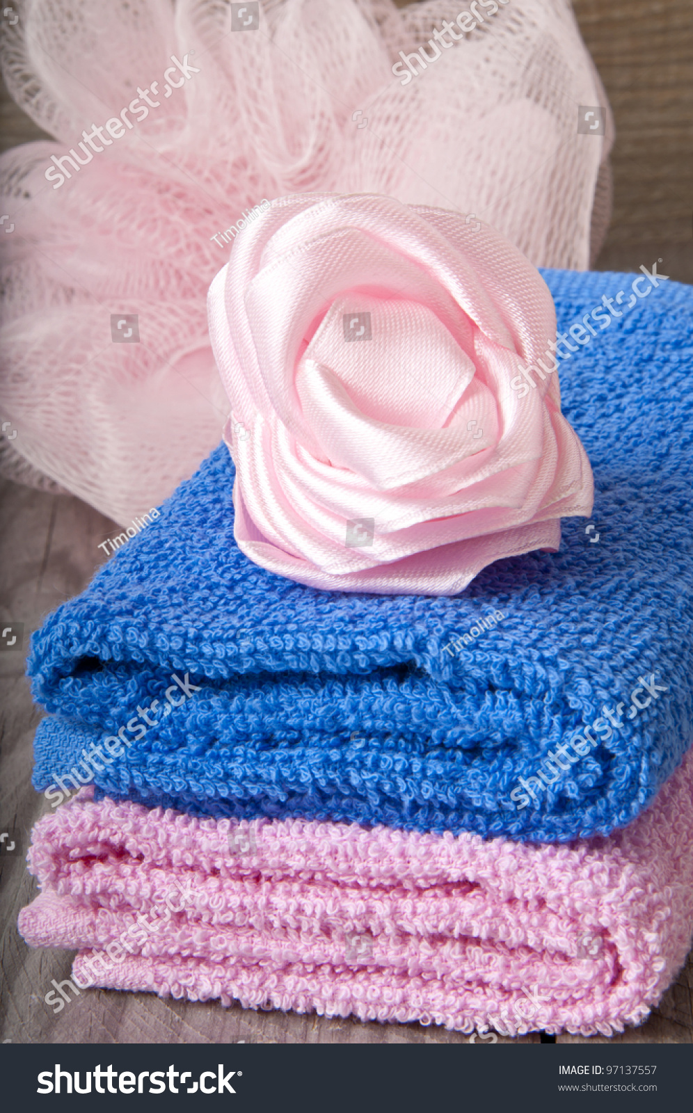 Pink and blue bath spa accessory over a wooden background for Pink and blue bathroom accessories
