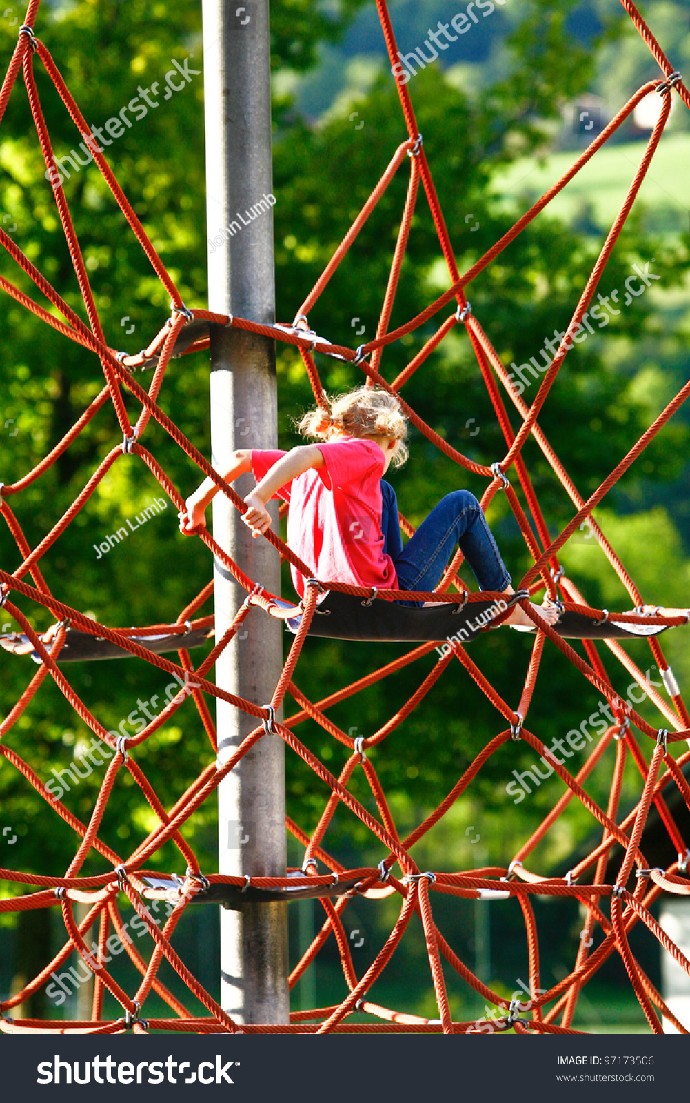 Small Blonde Girl Climbing Rope Climbing Stock Photo (Royalty Free ...