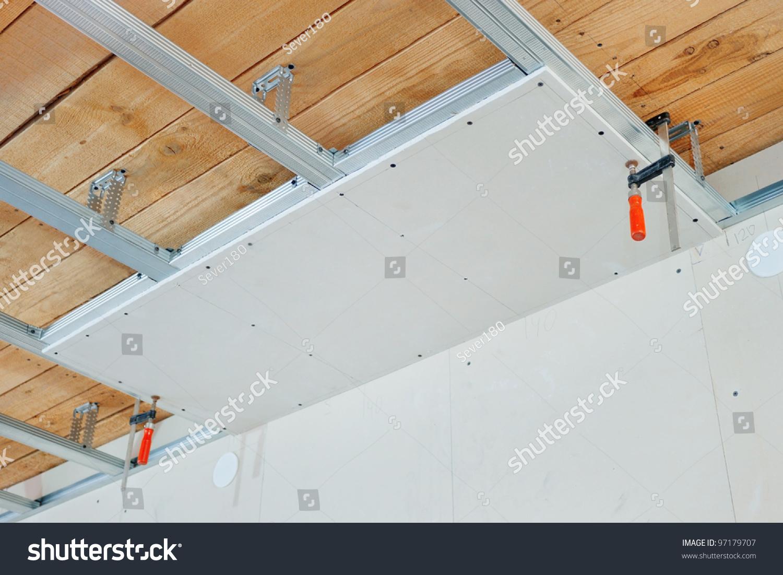 Gypsum Board Installation : Installation false ceiling gypsum board stock photo