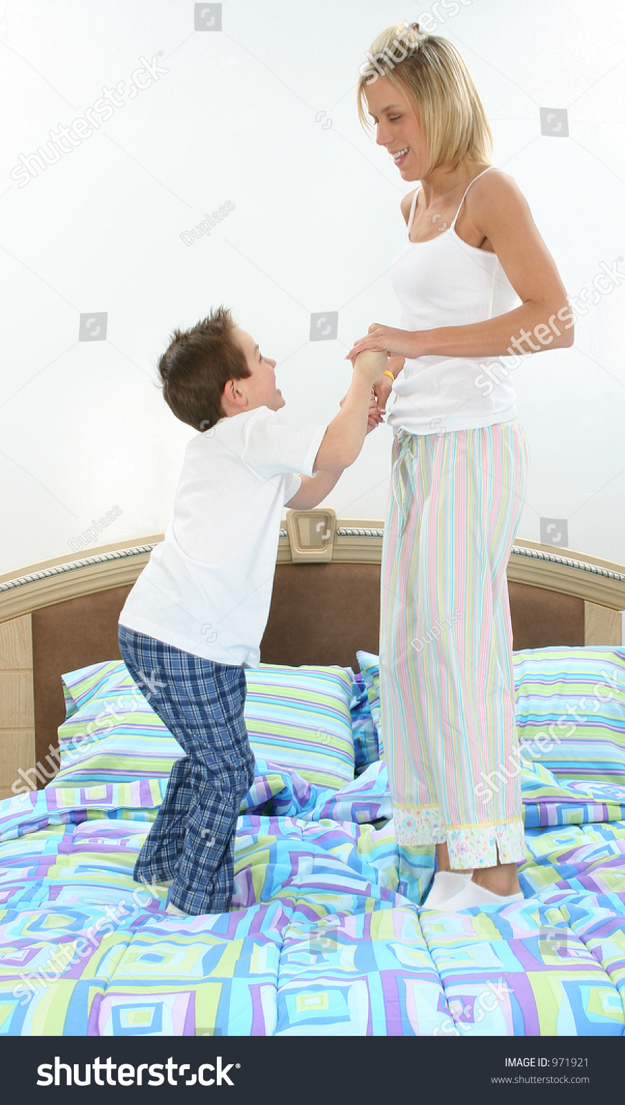 mom and son in pajamas playing in bed stock photo 971921 shutterstock. Black Bedroom Furniture Sets. Home Design Ideas