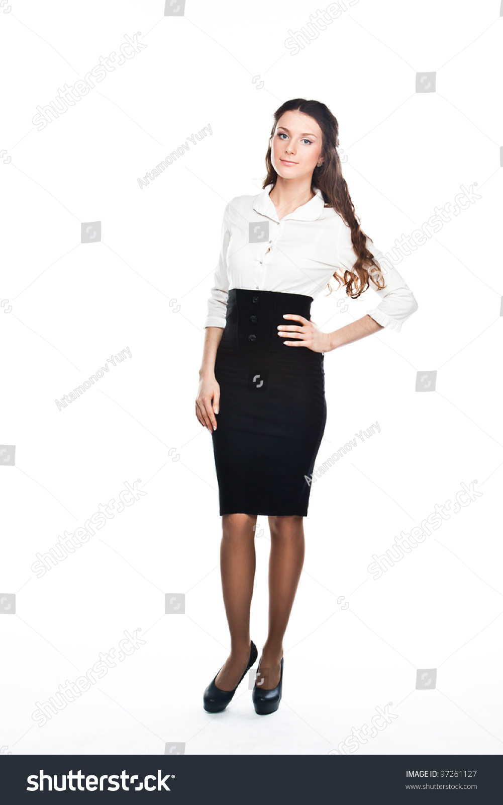 0c0ff322294006 Portrait of a young and beautiful business lady in a white blouse and black  skirt