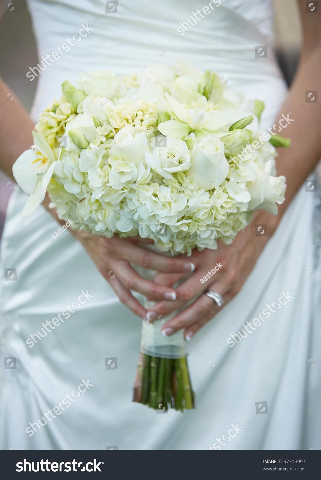 Bride holding wedding flower bouquet white stock photo edit now bride holding wedding flower bouquet of white roses izmirmasajfo