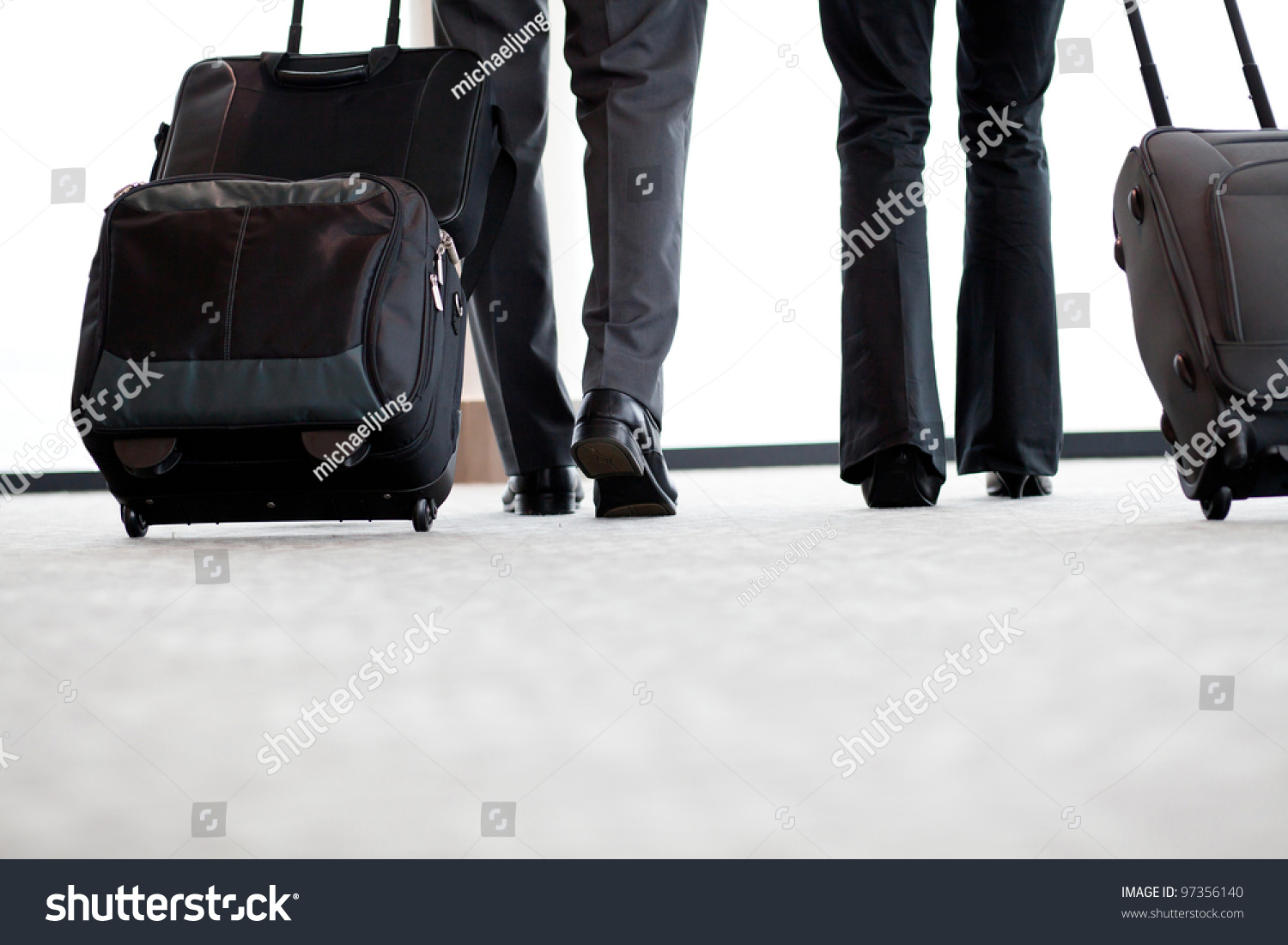Business Travellers Walking Airport Luggage Stock Photo 97356140 ...