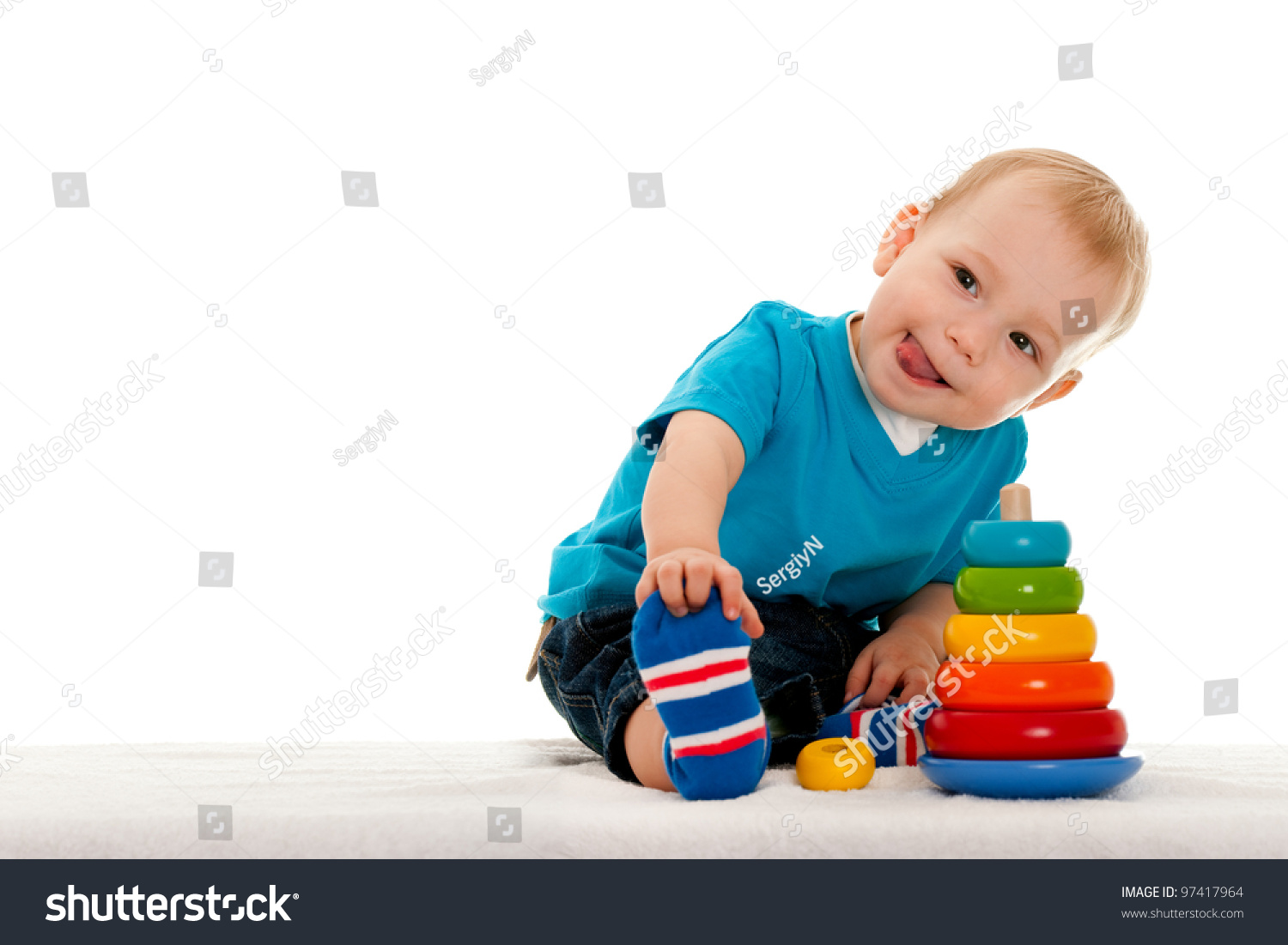 Boy Toys Background : A little boy is playing with toys on the blanket isolated