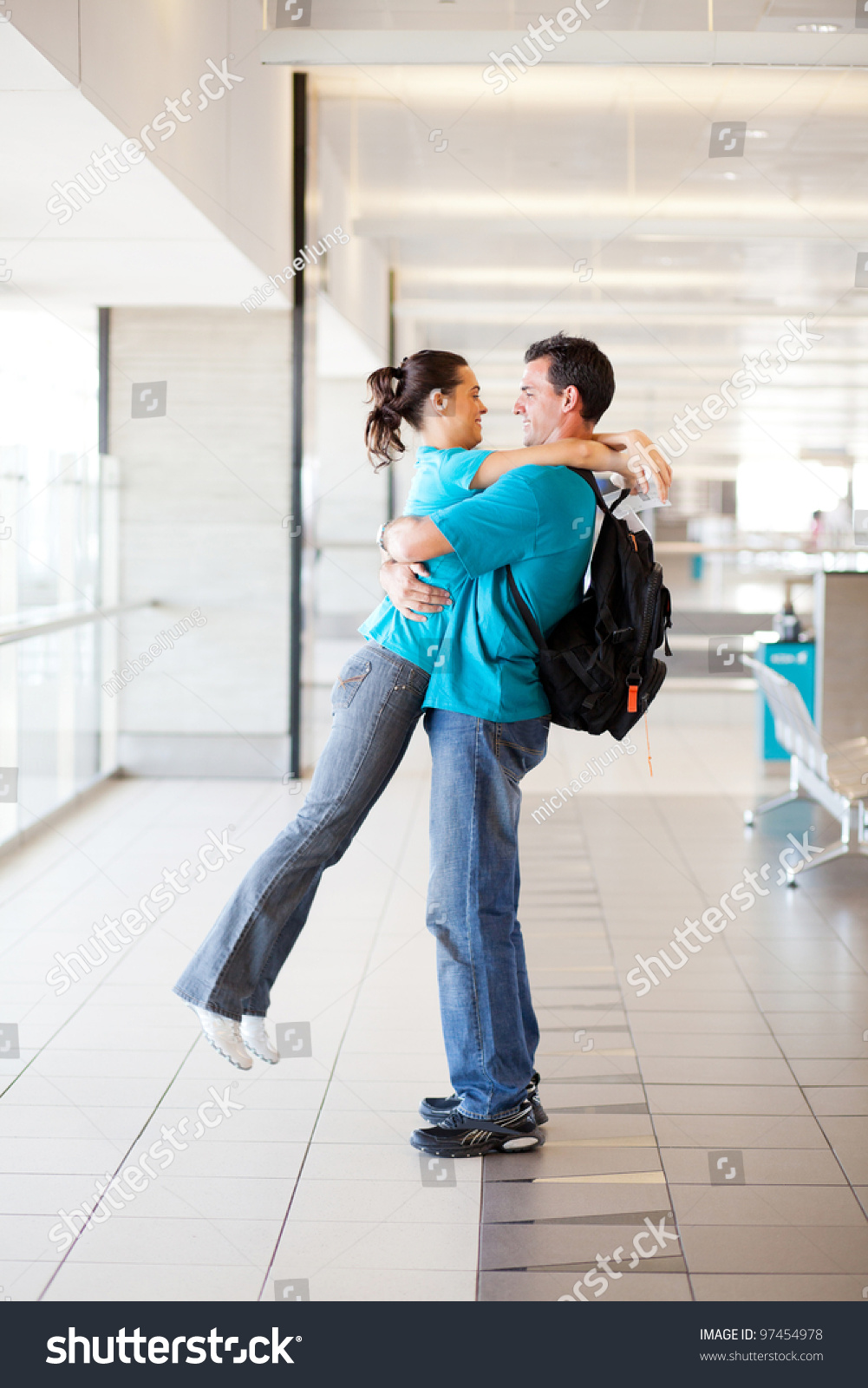 happy young couple hugging at airport. Happy Young Couple Hugging Airport Stock Photo 97454978   Shutterstock