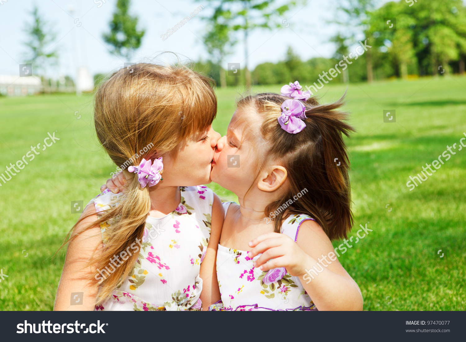 Little Sisters Kissing Each Other Stock Photo Edit Now 97470077