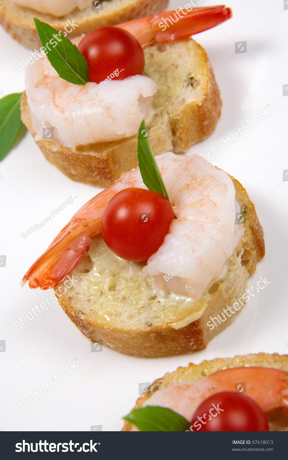Closeup of delicious shrimp canape with cherry tomatoes for Canape spread