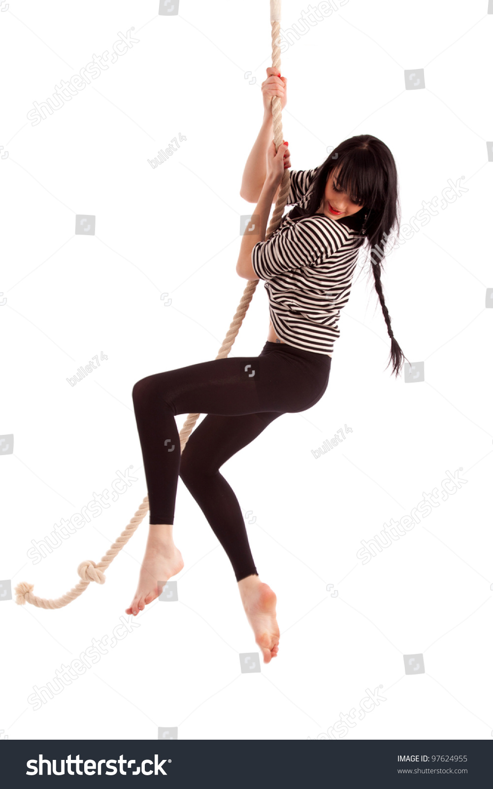 Boy and girl swinging on a rope
