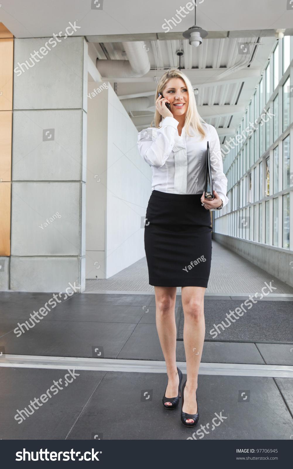 stock photo beautiful office lady talking phone walking