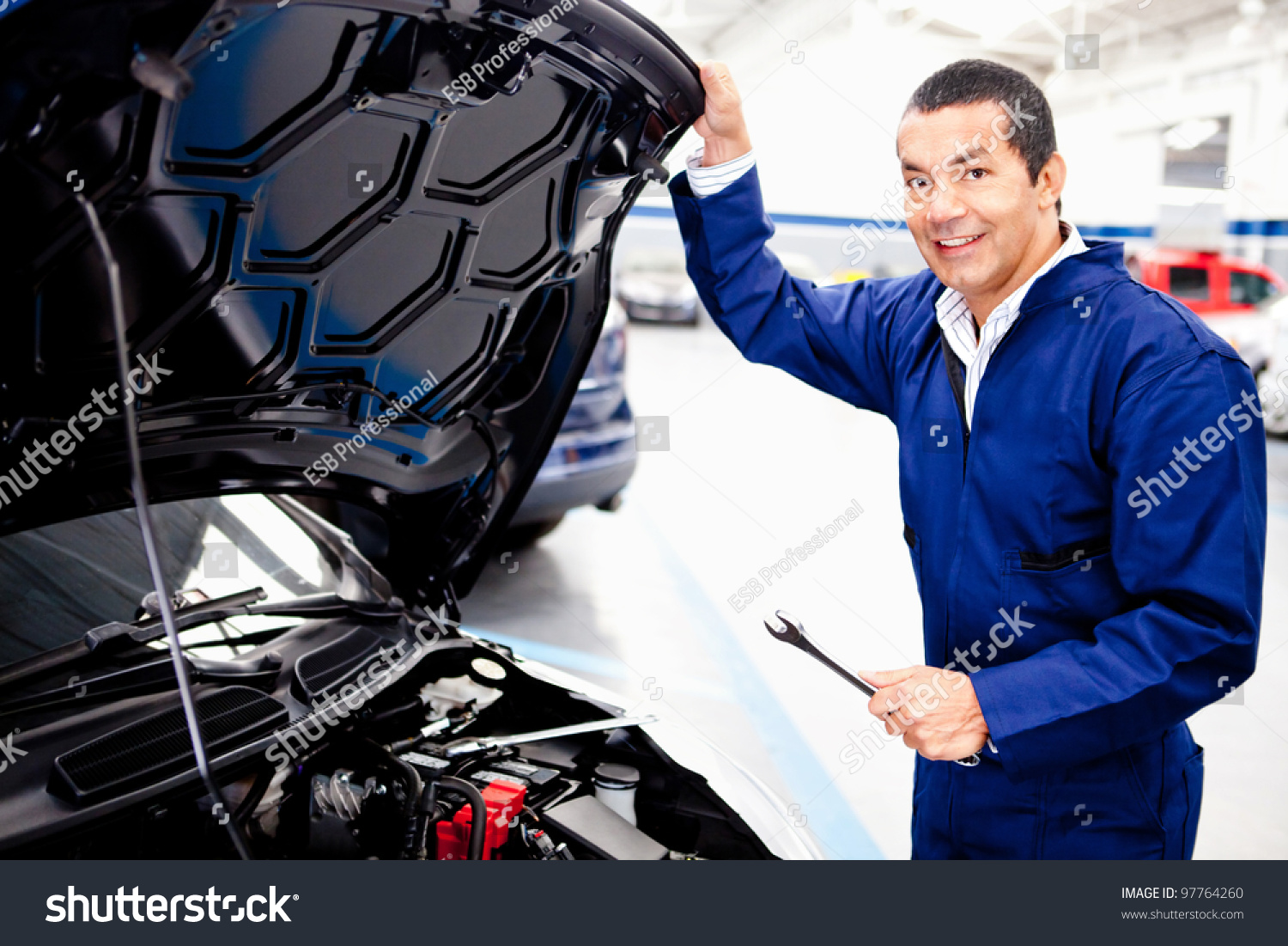 Car Mechanic Working On An Engine At The Repair Shop Stock Photo ...