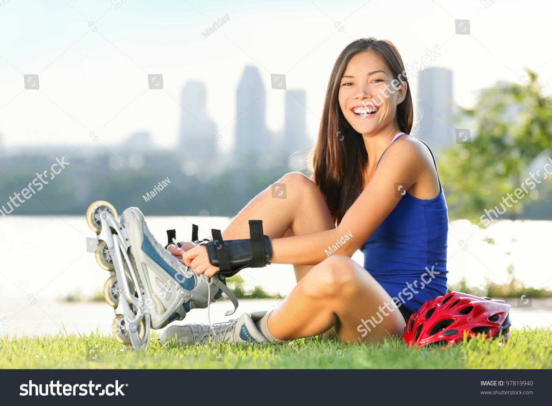 Roller skating quebec city - Roller Skate Girl Skating Young Woman Putting On Skates Going Rollerblading In Urban City Park