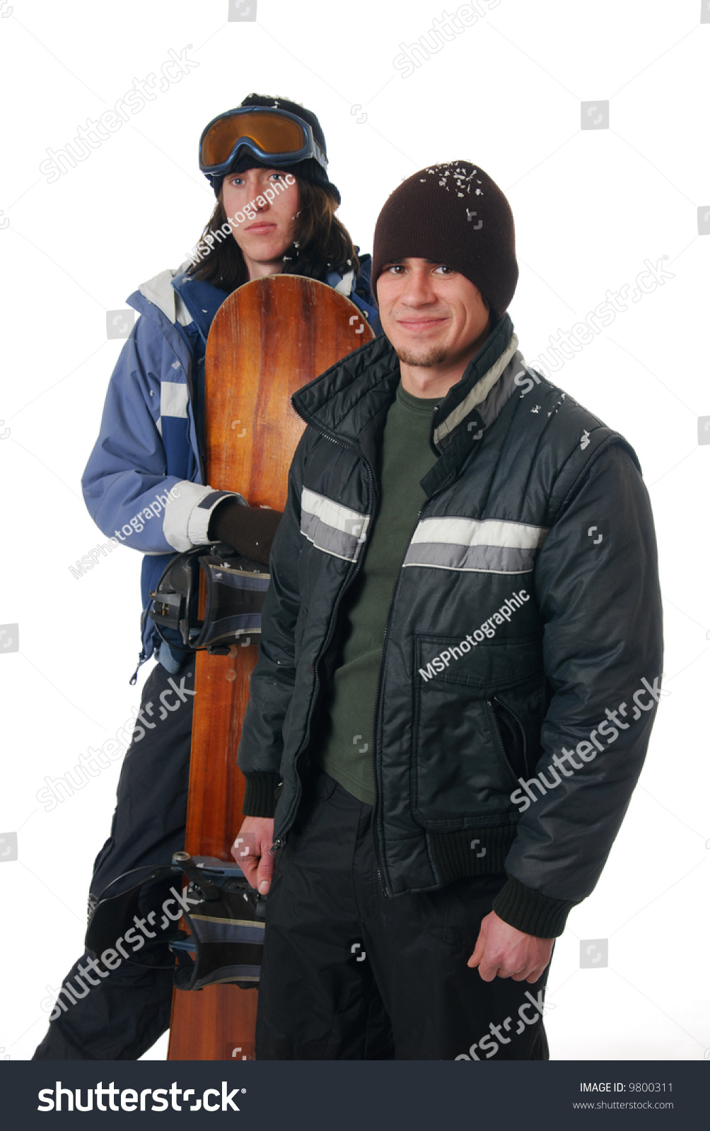 Two Young Men In Winter Coats With A Snowboard Stock Photo 9800311