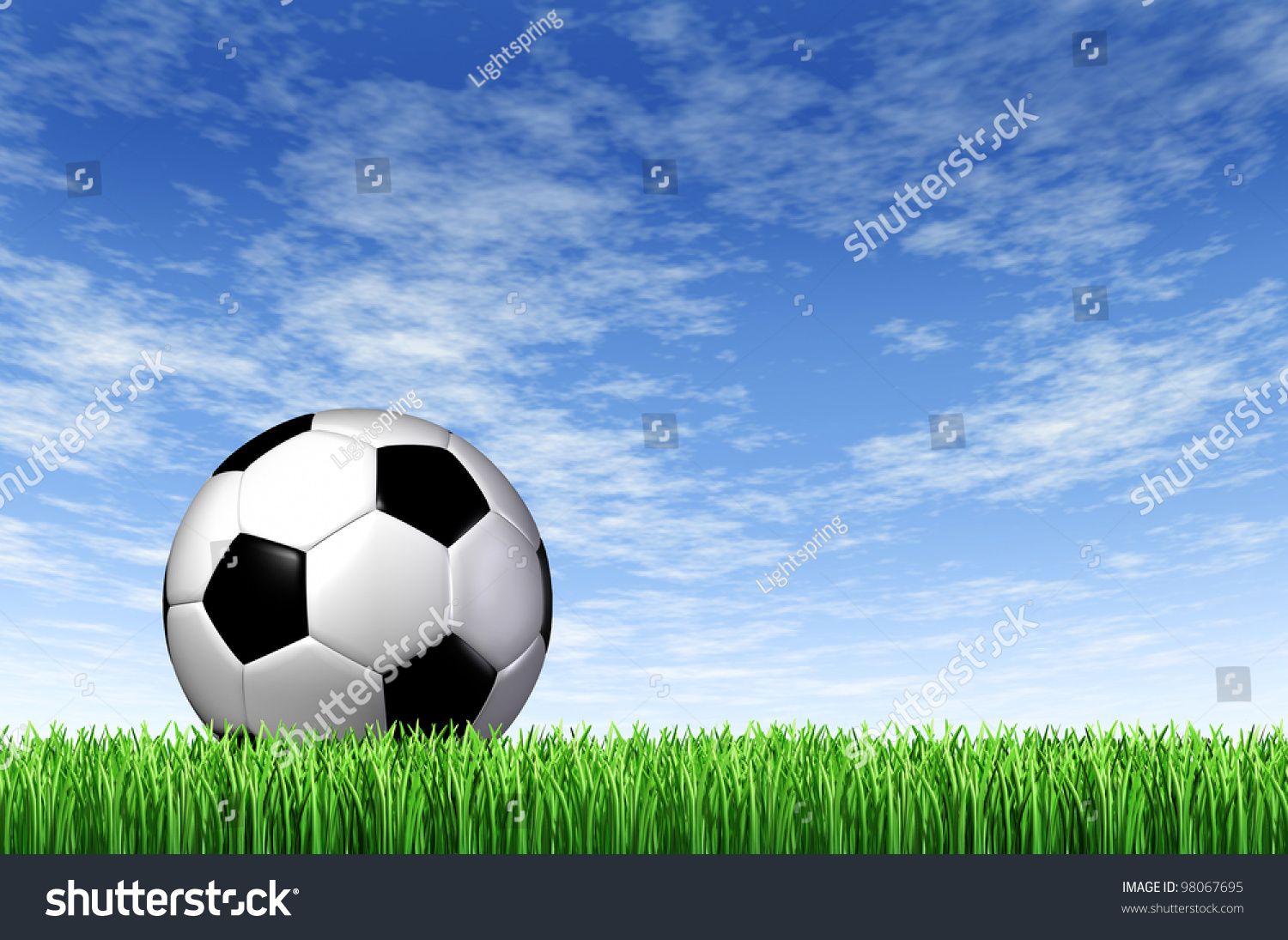 Soccer Football On Green Field With Blue Sky Background: Soccer Ball And Grass Field Background With A Blue Sky And