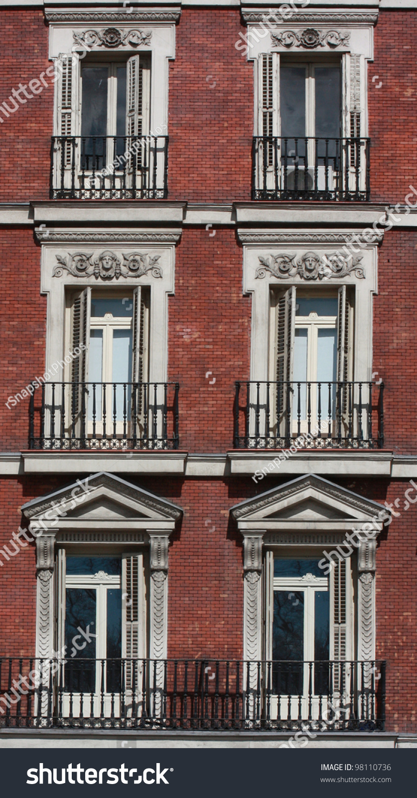 Brick Apartment Building Window gothic neo classical style ornate windows stock photo 98110736