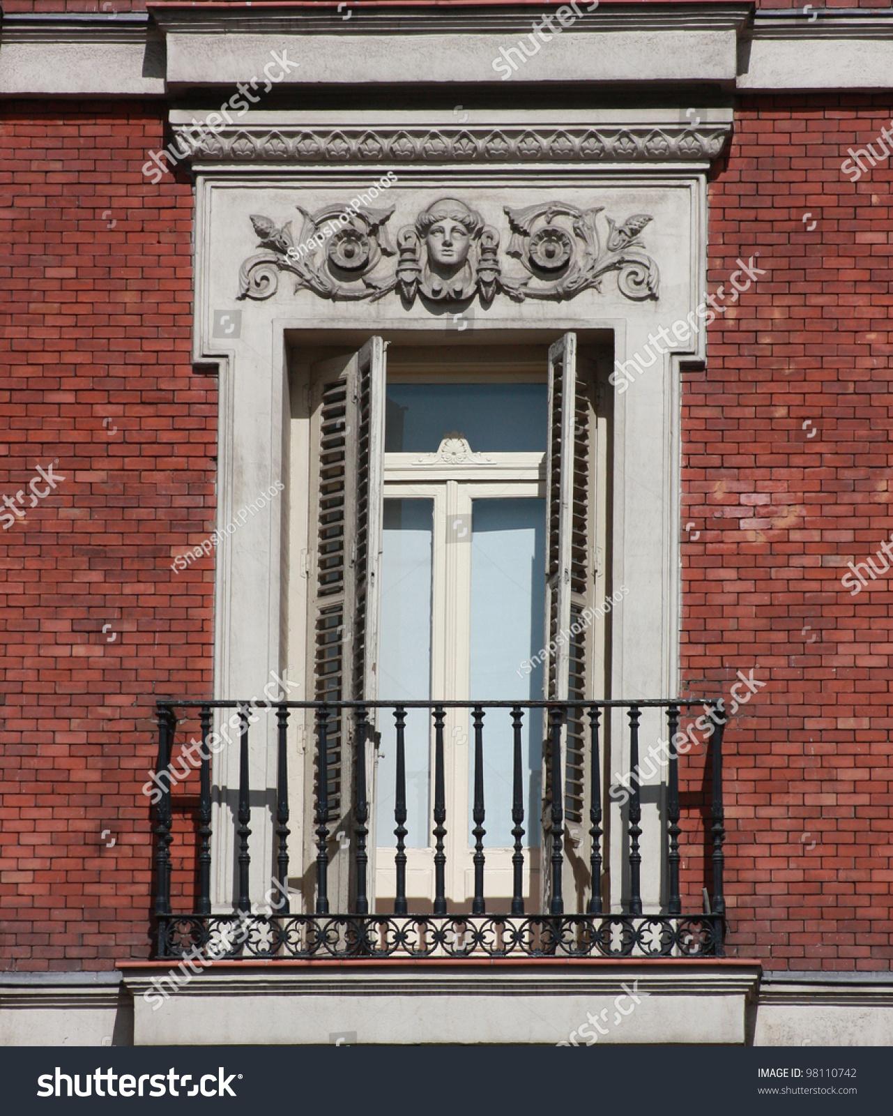 Brick Apartment Building Window neo classical gothic style window balcony stock photo 98110742