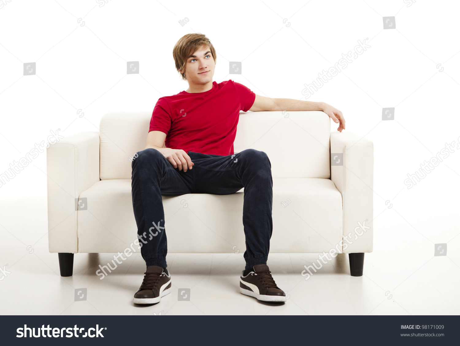 handsome young man home sitting on stock photo 98171009. Black Bedroom Furniture Sets. Home Design Ideas