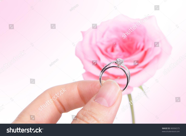 Hand Holding Romantic Diamond Wedding Ring Stock Photo (Royalty Free ...